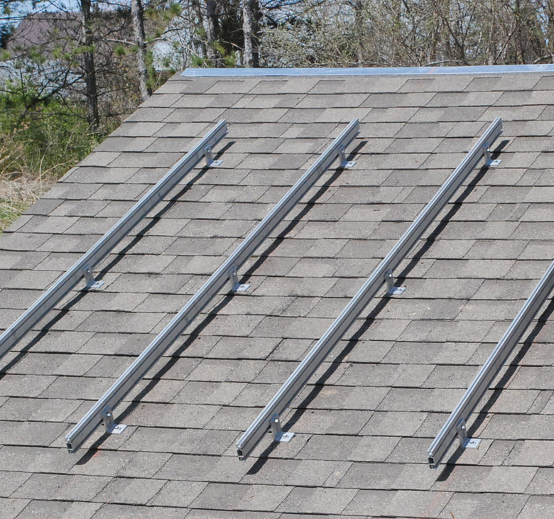 A picture of a roof with a set of Unirac mounting rails installed
