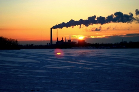 A coal-fired electricity generation plant at sunset